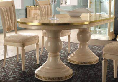 Τραπέζι οβάλ με κολώνες ιβουάρ με χρυσό μαίανδρο